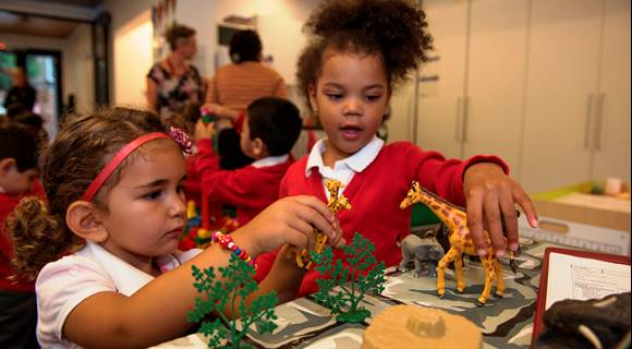 SELA EYFS children with small world