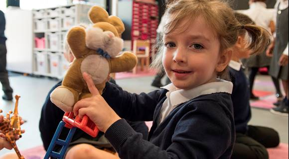SELA EYFS child with teddy